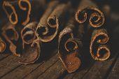 pic of cinnamon sticks  - Close up of cinnamon sticks on wooden background - JPG
