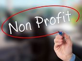 picture of non-profit  - Man Hand writing Non Profit with marker on virtual screen - JPG