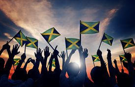 pic of jamaican flag  - Group of People Waving Flag of Jamaica in Back Lit Concept - JPG