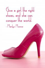 stock photo of stiletto  - Pink high heel shoe on pink wood shabby chic table with Give A Girl the Right Shoes quote - JPG
