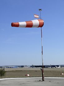 foto of stiff  - A windsock at an airfield showing a stiff breeze - JPG