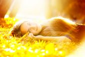 beautiful woman in sunbeam lying on the grass