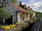 Thornton Dale, North Yorkshire - houses by stream.