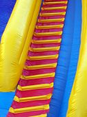 Ladder on inflatable fun slide.