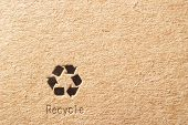 cardboard box background with recycle symbol