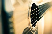 stock photo of western saddle  - detail of classic guitar with shallow depth of field - JPG