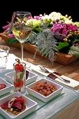 pic of flower arrangement  - restaurant table with snack and flowers arrangement - JPG