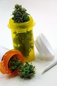 stock photo of marijuana  - 2 pill jars filled with marijuana represents medical marijuana as a prescription - JPG
