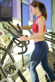 picture of cardio exercise  - a woman does some cardio exercise on a step machine - JPG