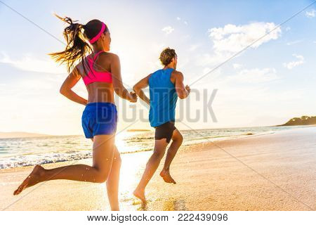poster of Runners fitness couple running training on beach. Morning cardio workout people doing exercise.Activ