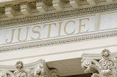 stock photo of magistrate  - justice word engraved on the pediment of the courthouse - JPG