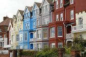 stock photo of beach-house  - multi colored houses on a beach front in suffolk county england - JPG