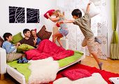 stock photo of pillow-fight  - a young family is making a pillow - JPG