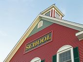pic of school building  - Colonial House School Building Against Blue Sky - JPG