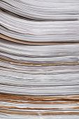 Stack of old paper documents in archive, closeup poster
