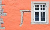 Window and orange wall