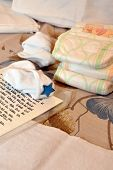 Diapers, white socks and text with a prayer