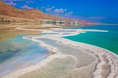 Dead Sea, Israel. Reduced water in the very salty Dead Sea. The evaporated salt is precipitated by p poster