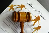 picture of divorce-papers  - divorce papers and gavel with paper family - JPG