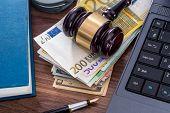 Wooden Hammer, Handcuffs And Euro Bills, Laptop On Desk. poster