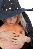 picture of jack-o-laterns-jack-o-latern  - Young blond girl dresses in hallowwen witch costume - JPG