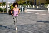 Black Woman, Afro Hairstyle, Running Outdoors At Sunset poster