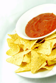 picture of doritos  - Plate of nachos and hot salsa dip sauce  - JPG