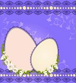 Decorative eggs on the background of lace and flowers