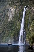 Water Fall And Boat In The Milford Sound