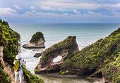 New Zealand. Huge rocks and stones off the coast of the South Island. The picturesque Pacific coast  poster