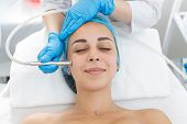 Beautician Procedure Diamond Microdermabrasion Patient Face. A Young Girl Is Undergoing A Course Of  poster