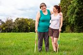 Mental Disabled Woman Is Playing Crocket To Train Her Motor Abilities, Exercises With A Friend Or Th poster