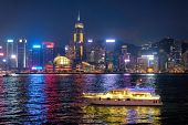 Hong Kong skyline cityscape downtown skyscrapers over Victoria Harbour in the evening illuminated wi poster