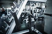 Bodybuilder Sport Fitness Equipment For Muscle Exercising And Workout Machine In Gym Background. Bod poster