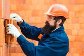 Construction Worker Contractor Man. Orange Buid Background. Bricklayer Industrial Worker Installing  poster
