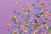 Sprinkle Background With Rainbow Sprinkle Shapes, Stars, Stripes, Little Balls On Lilac Background,  poster