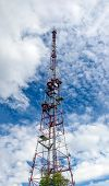 Telecommunication Tower With A Lot Of Antennas Against Blue Sky With Clouds. Telecommunication Tower poster