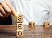 Blocks With The Word Seo And Businessman. Search Engine Optimization. Increase The Quality And Quant poster