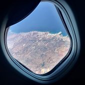 Beautiful View From Airplane Window, Large Wing Of Aircraft Shows Casement. Windows Aircraft Show Lo poster