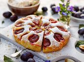 Plum Cake, Traditional Homemade  Cake With Fruit, Divided Into Portions, Sprinkled With Powdered Sug poster