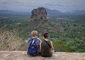 The Couple In Love On A Rock Admires The Beautiful Views At  Pidurangala Mountain. poster