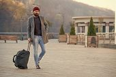 Hipster Ready Enjoy Travel. Looking For Accommodation. Man Bearded Hipster Travel With Big Luggage B poster