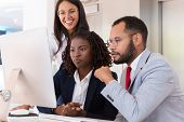 Excited Diverse Business Team Watching Video On Desktop. Business Man And Women Sitting At Table, Us poster