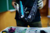 Technician Hand Cleaning Printer Toner Cartridge.  Used Laser Toner Cartridge. poster