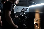 Behind The Scenes Of Filming Movies And Video Products, Setting Up Equipment For Shooting Video And  poster