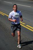 BELGRADE, SERBIA - APRIL 22: Undefined man runs on April 22, 2012 in Belgrade marathon