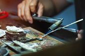 Silverware Making. Craftsman Are Making Silverware.the Original Of The Silver Craftsmen At Chiang Ma poster