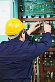 Electrician at safety fuse device replace work at electric power switch line box