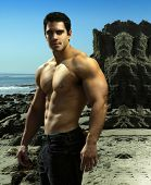 Dramatic outdoor portrait of a very muscular male fitness bodybuilder