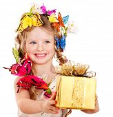 Little girl with spring flower and gift box. Isolated.